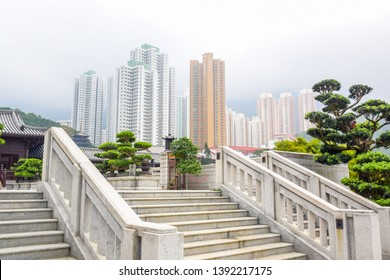 Stairway connection between Nan Lian Garden and Chi Lin Nunnery with skyscraper buildings in background, one of a popular tourists destination in Hong Kong