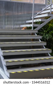 Stairway gray metallic banister in a new modern building interior architecture