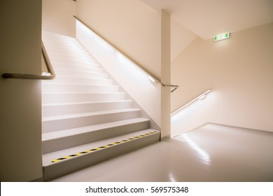 Stairway leading down and up with bright light