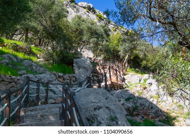 Stairway leading to the Karain cave in Antalya of Turkey, April 2018. Karain Cave, is situated on the slopes of Sam mountain, on the altitude of 390 meters above sea level.