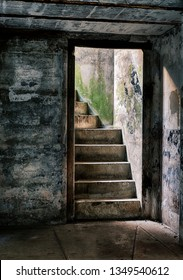 A stairway leads upwards towards the light from one of the underground supply rooms at Fort Casey on Whidbey Island in Washington State.