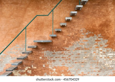 A stairway on a brick wall