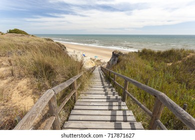 Stairway to the Playa del Asperillo beach in Matalascanas.  Donana Natural Park, Huelva province, Costa de la Luz, Andalusia, Spain