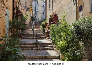 Stairway, a souvenir shop and historical houses in the old part of Marseille, France
