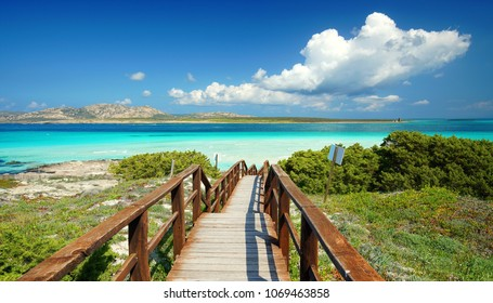 stairway to turquoise water and white sand beach lagoon