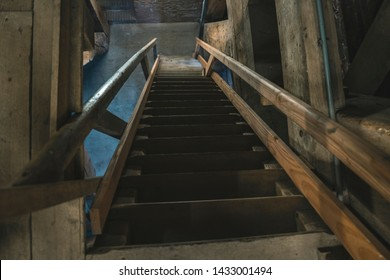 Stairwell in the church with wooden stairs