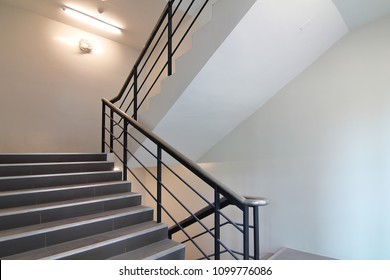 Stairwell to emergency exit or stairwell fire escape in office building.