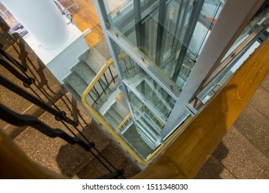 The stairwell and glass Elevator in a spatial perspective