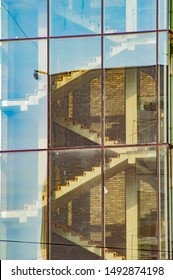 Stairwells behind the transparent glass of the building. Background image.