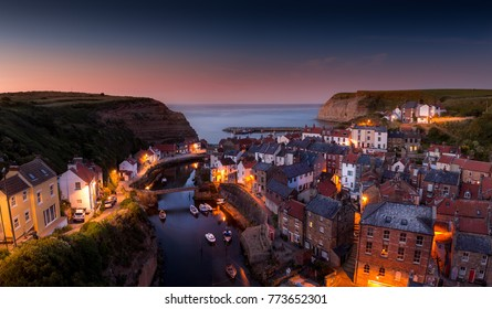 Staithes after sunset with an afterglow  on the horizon