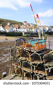 STAITHES, ENGLAND - APRIL 21: Staithes beach with lobster traps in the foreground. In Staithes, England. On 21st April 2018.