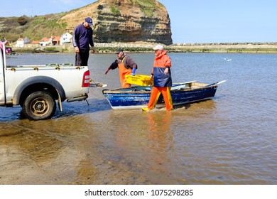 STAITHES, ENGLAND - APRIL 21: Staithes fishermen loading catch of freshly caught lobster onto truck. In Staithes, England. On 21st April 2018.