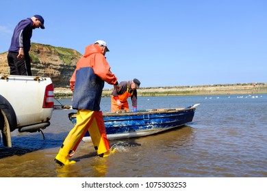 STAITHES, ENGLAND - APRIL 21: Staithes fishermen unloading catch of freshly caught lobster. In Staithes, England. On 21st April 2018.