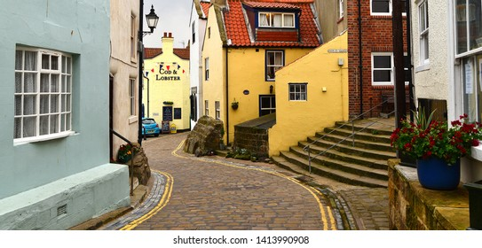 Staithes, North Yorkshire, UK 06/28/2015 Cobbled village street background