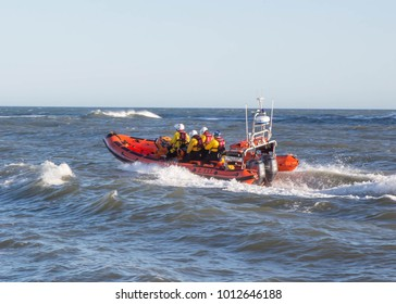 STAITHES NORTH YORKSHIRE, UK - JANUARY 29 2018: The Royal National Lifeboat  Institution inshore lifeboat being used for training purposes at Staithes, UK.