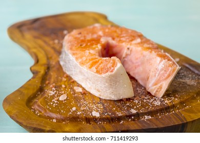 Stake salmon on wooden board