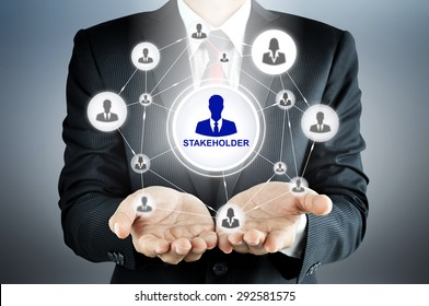 STAKEHOLDER sign with businesspeople icon network on businessman hands