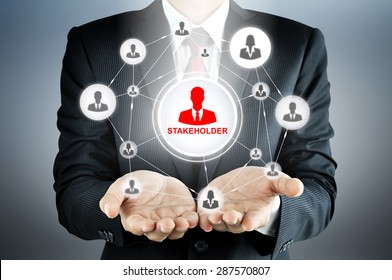 STAKEHOLDER sign connected with businesspeople icon network on businessman hands