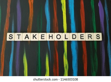 Stakeholders letters on black and multi colored background