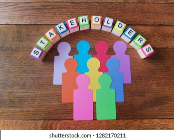 Stakeholders text with colorful representatives on wood background