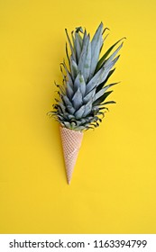 The stalk of a pineapple in an ice cream cone against a monochrome background as a symbol of pineapple ice cream as a fruity refreshment in summer