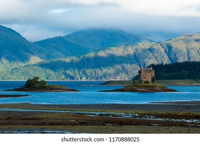 stalker castle is a four-storey tower house, which stands in a picturesque position on a small tidal island in Loch Laich, Loch Linnescotland united kingdom europe