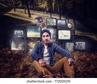 Stalker, mountain of old TVs on background