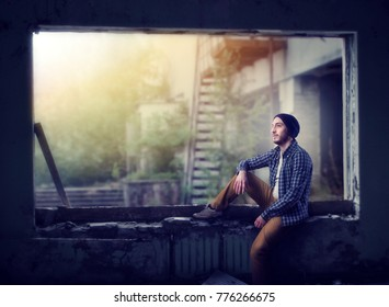 Stalker sitting on the window, abandoned city