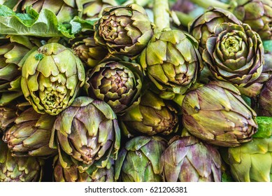 Stall with artichokes on market place of Ortygia isle, Syracuse city, Sicily Island in Italy