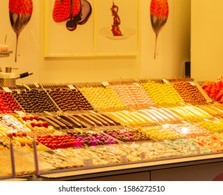 Stall with candied fruits, Candied apples and sweets at the Hamburger Winter Dom - Shutterstock ID 1586272510
