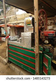 A stall of churning out fresh sugarcane juice at a roadside (In arabic Mashallah is written which means May God Bless You)