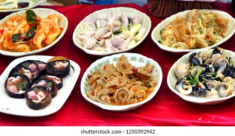 A stall at a local night market in Taiwan sells seafood dishes