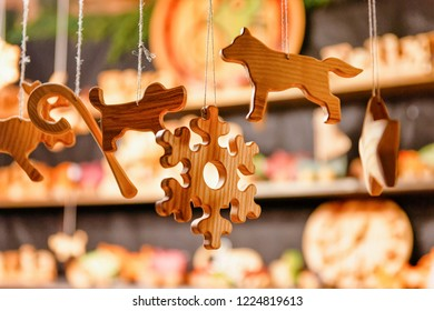 Stall with wooden toys decoration and Christmas market, in winter Riga in Latvia.