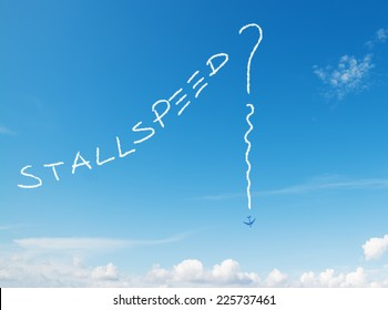 """stall speed?"" written in the sky with contrails left by airplane"