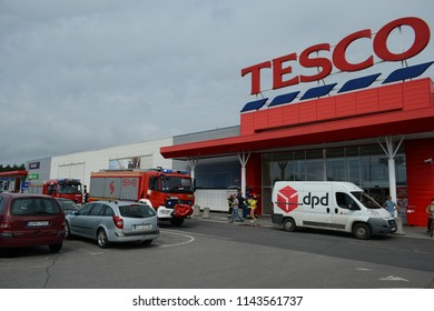 Stalowa Wola, Poland 27.07.2018 The guy drove the tractor to the TESCO store. Broke the door, broke the glass with an ax in the APART watch store