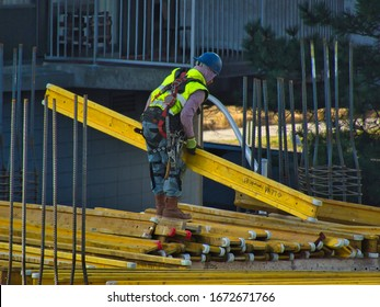 Stamford, Connecticut / USA - March 12, 2020 :Concrete Workers positioning Lana beams at The Smyth Building Site in downtown Stamford.