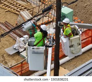 Stamford, Connecticut / USA - September 10,2019: Optimum Linemen working bucket lifts near The Smyth Building Site in Stamford Connecticut