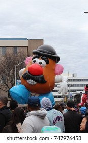 STAMFORD, CT - NOVEMBER 22, 2015: Mr.Potato Head  is floating above the crowds in the UBS Parade Spectacular on November 22, 2015 in Stamford, CT