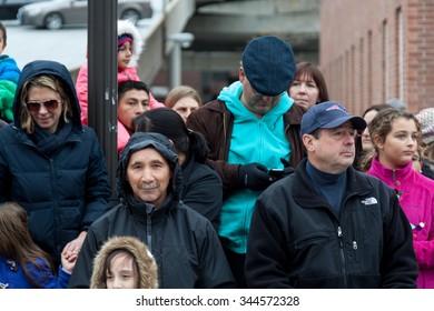 "Stamford, CT, USA - November 22, 2015: Spectators enjoying the annual ""Thanksgiving Day"" parade in downtown Stamford on November 22, 2015."