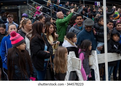 "Stamford, CT, USA - November 22, 2015: Spectators enjoying the annual ""Thanksgiving Day"" parade in downtown Stamford on November 22, 2015"