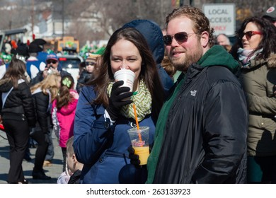 """Stamford, USA - March 7, 2015: The Individuals are some of the many spectatorson who on March 7, 2015,  are enjoying the annual """"St. Patrick's Day"""" parade in Stamford Connecticut."""