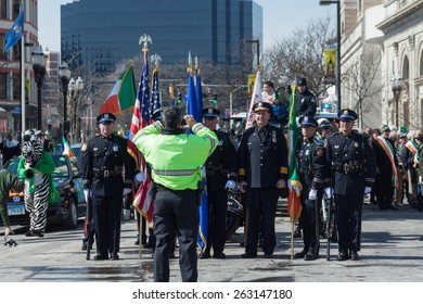 "Stamford, USA - March 7, 2015: The individuals are some of the many people participating in the annual ""St. Patrick's Day"" parade in downtown Stamford on March 7, 2015."