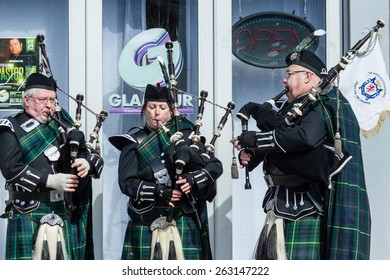 """Stamford, USA - March 7, 2015: The individuals are some of the many people participating in the annual """"St. Patrick's Day"""" parade in downtown Stamford on March 7, 2015."""