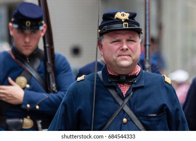 """Stamford, USA - May 28, 2017: The individuals who are dressed in a """"American Civil War"""" attire are participating in the annual """"Memorial Day Parade"""" held in Stamford, Connecticut."""