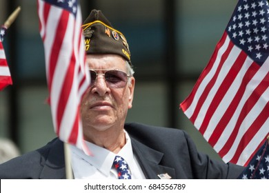 """Stamford, USA - May 28, 2017: The individual, a Veteran, is participating at the annual """"Memorial Day Parade"""" held in Stamford, Connecticut."""