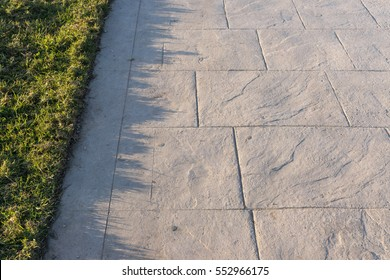 Stamped concrete pavement slate stone pattern, decorative appearance colors and textures of paving slate stone tile on cement flooring exterior decorative, perspective