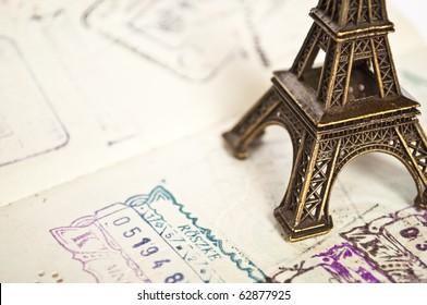 Stamped passport with Eiffel passport - travel to Paris concept -