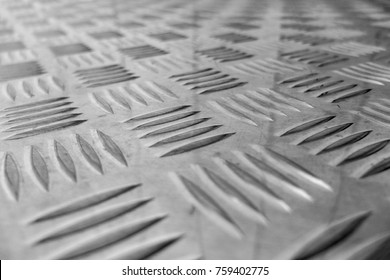 Stamped stainless steel. Diagonal texture.