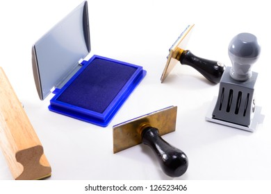 STAMPER WITH STAMP PAD ON WHITE ISOLATED BACKGROUND