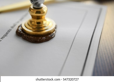 Stamping old notarial wax seal on document